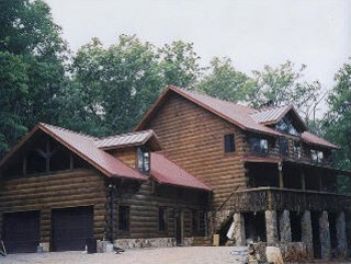 r-panel metal roof install in Knoxville log cabin home