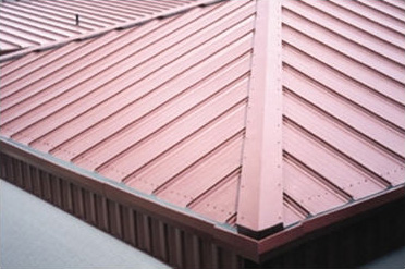 closeup of standing seam metal roof panel on commercial building