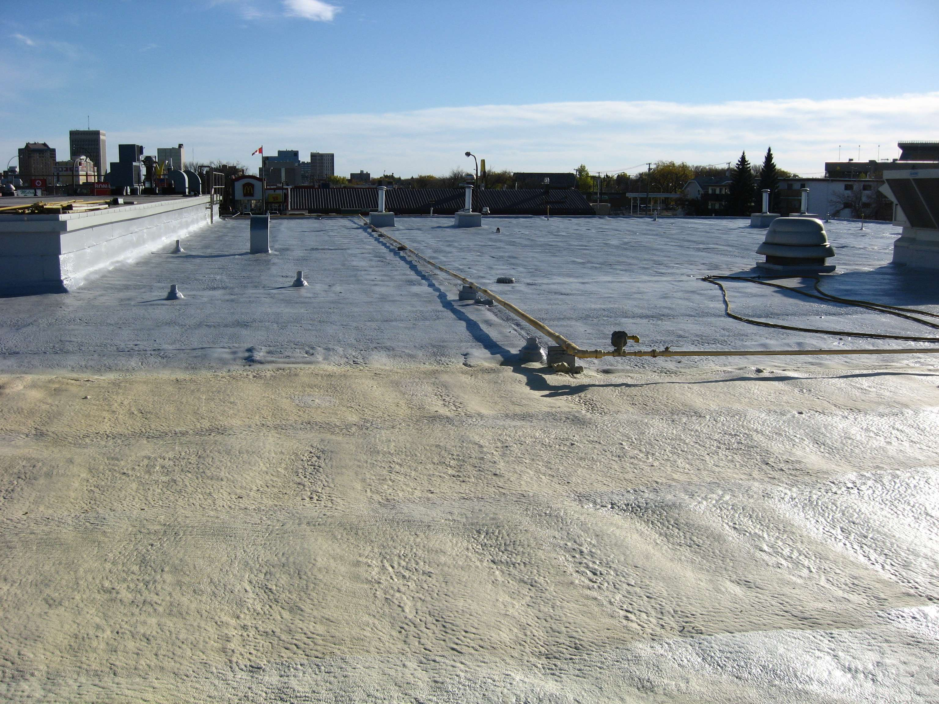 Spray Foam Roofing Also Gives Buildings Excellent Insulation Value And A  Light Colored Roofing Surface, Which Generally Reduces The Amount Of Air ...