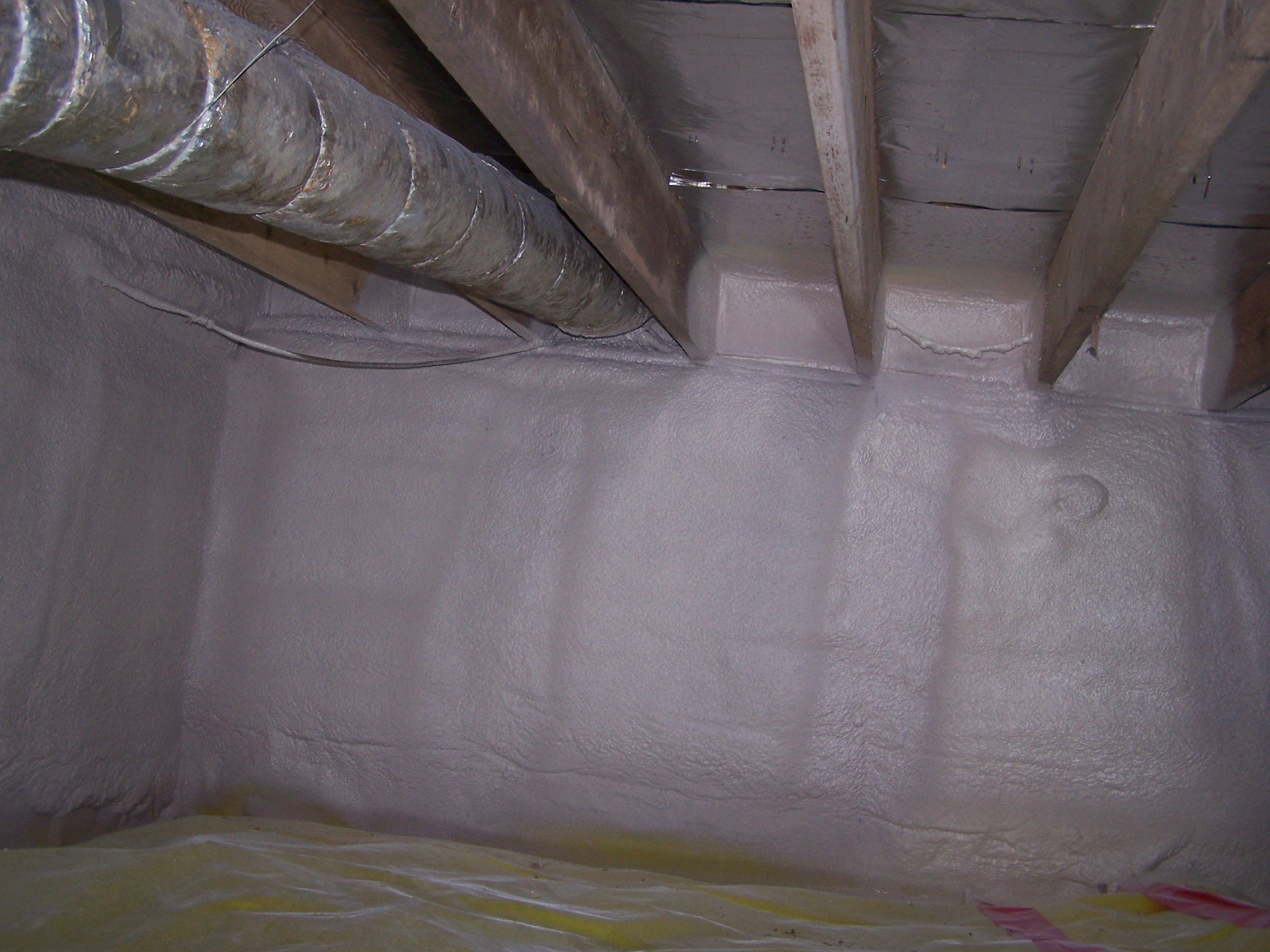 The crawlspace foundation walls are insulated with closed cell spray foam insulation.